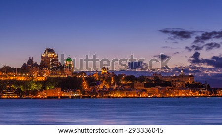 View of Quebec City from Levis at twilight with the famous  Frontenac Castle, a hotel which dominates the skyline and the ramparts surrounding the old city. - stock photo