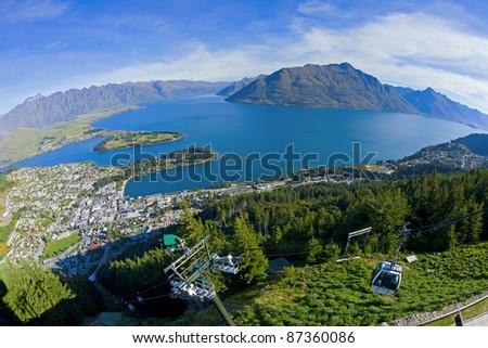 View of Queenstown and Lake Wakatipu from the Skyline Gondola - stock photo