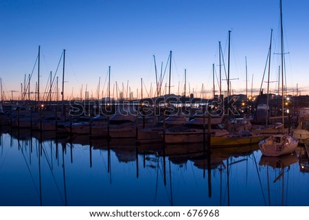 View of Rangitoto Island taken from Westhaven Marina looking over moored yachts - stock photo
