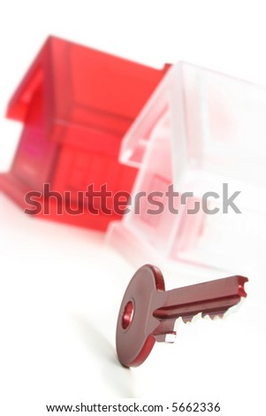 view of red key with house figure on the white - stock photo