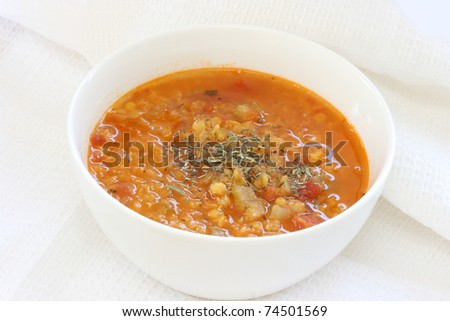View of red lentil soup in white bowl, - stock photo