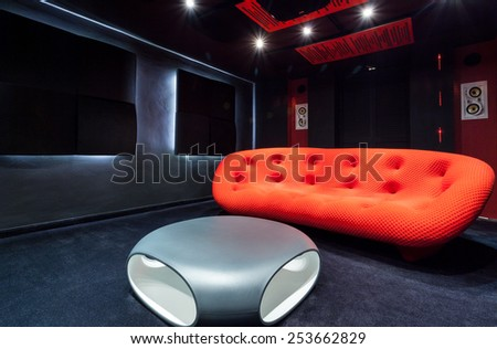 View of red sofa at home cinema - stock photo