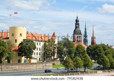 View of Riga Castle, Cathedral, St. Peter's Church and The Factory Church of St. Savior - stock photo