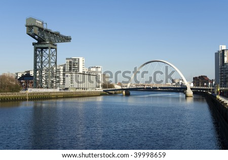 View of River Clyde, Glasgow, Scotland, UK, Europe. Image features Squinty Bridge, known as the Clyde Arc, and the Clydeport crane. - stock photo