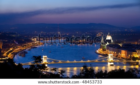 View of river Danube and Chain Bridge in Budapest shot during magic hour just after sunset. - stock photo