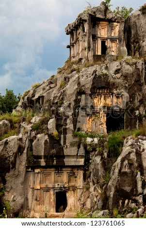 View of rock cut tombs of Myra and sky - stock photo