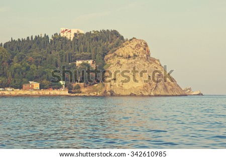 View of rocky cape Plaka, Crimea coastline. Image with vintage filter - stock photo