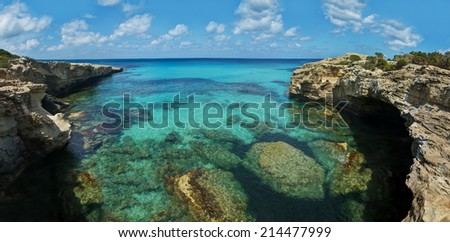 view of rocky coast and transparent sea waters with corals on Akamas peninsula, Cyprus - stock photo