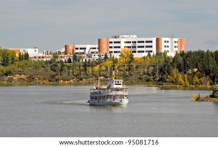 View of Rockyview Hospital and Ferry on the Glenmore Reservoir, Calgary, Alberta, Canada - stock photo