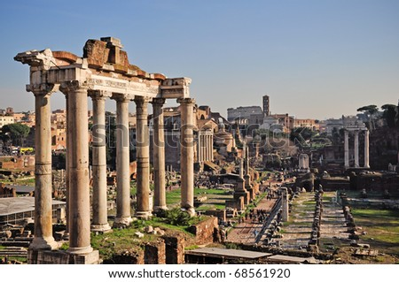 View of Roman Forum, focus on the Saturn's Temple in foreground. Ancient roman ruins in Rome, Italy.