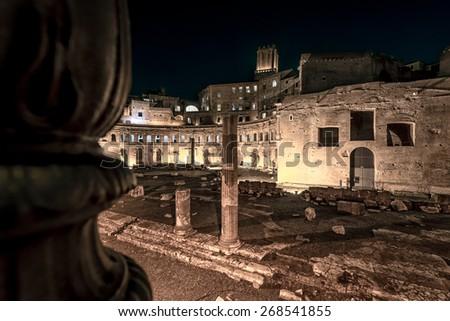 View of Roman Forum, Trajan's column in Rome at night - stock photo