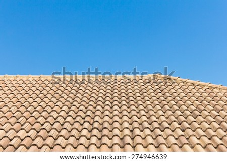 View of roof tiles and blue sky on the background