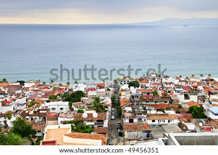 View of rooftops and Pacific ocean in Puerto Vallarta, Mexico - stock photo