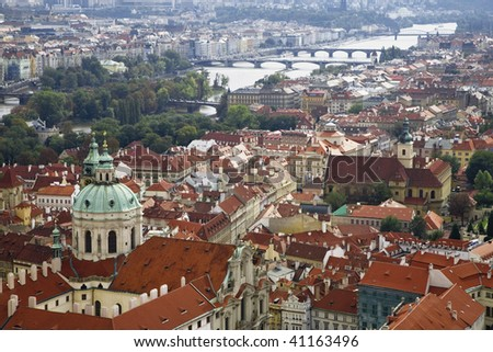 View of rooftops in the Little Quarter and the Vltava River from the Renaissance bell tower of St Vitus's Cathedral in the Prague Castle and Hradcany region.