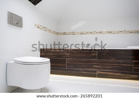 View of round toilet inside small bathroom