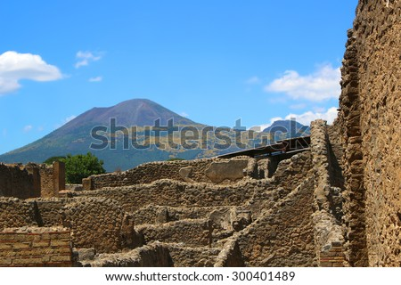 View of ruins in the old city of Pompeii, Italy with Mount Vesuvius in the background - stock photo
