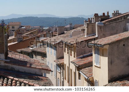 View of rustic European town amongst mountains on sunny day