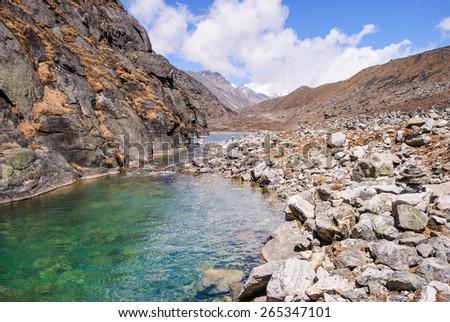 View of sacred Gokyo lake on Gokyo/Everest Base Camp trek, Everest Region, Nepal - stock photo