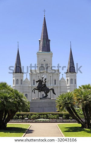 View of Saint Louis Cathedral and General Andrew Jackson statue from across Jackson Square in the French Quarter of New Orleans, Louisiana. - stock photo