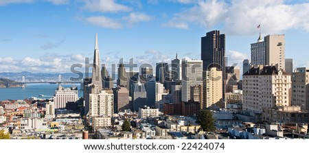 View of San Francisco downtown and financial district, with the Bay Bridge in the background. - stock photo