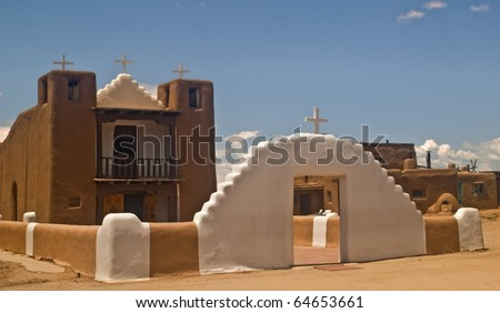 View of San Geronimo (Saint Jerome) Catholic Church at Taos Pueblo in New Mexico- the oldest continuous inhabited community in the United States. - stock photo