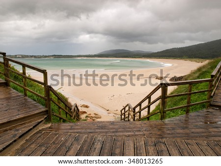 View of San Jorge beach in a rainy day in Ferrol, Galicia, Spain. - stock photo