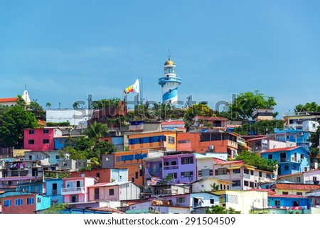 View of Santa Ana hill and the Las Penas neighborhood in Guayaquil, Ecuador with a lighthouse on top - stock photo
