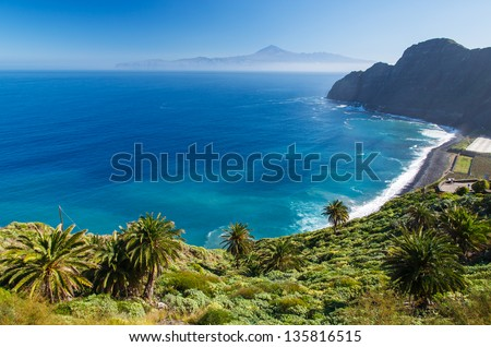 View of Santa Catalina beach and mountains with Tenerife island in the background, La Gomera island - stock photo