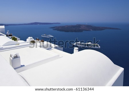 View of Santorini from the white washed houses - stock photo