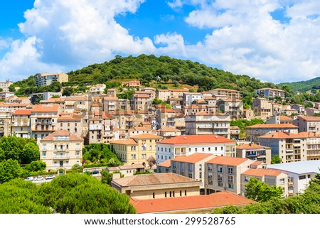 View of Sartene village with stone houses built in traditional Corsican style on top of a green hill, France  - stock photo