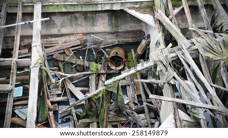 View of Scattered Rubbish in a Flooded Derelict Building - stock photo