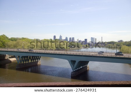 View of Schuylkill River and Philadelphia skyline from moving Amtrak train, Philadelphia, Pennsylvania - stock photo
