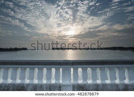View of sea and beautiful sunset from white bridge