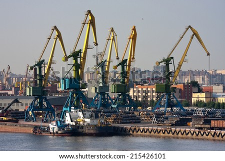 View of sea trade port with ships and cranes - stock photo