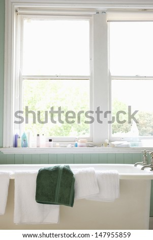 View of several towels on bathtub in the bathroom - stock photo