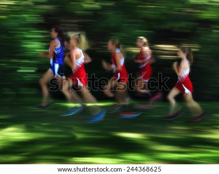 View of several women runners blurred running race - stock photo