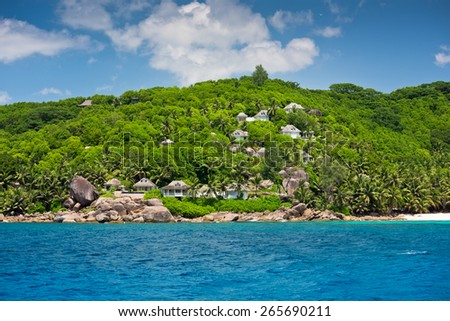 View of Seychelles coastline with houses in the forest. Horizontal shot - stock photo