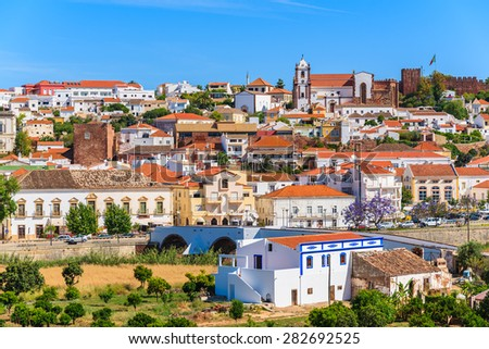View of Silves town buildings with famous castle and cathedral, Algarve region, Portugal - stock photo