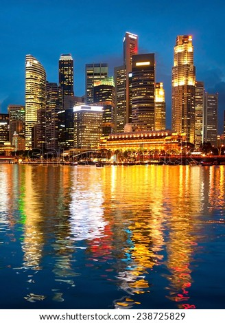 View of Singapore downtown with reflection in a river - stock photo