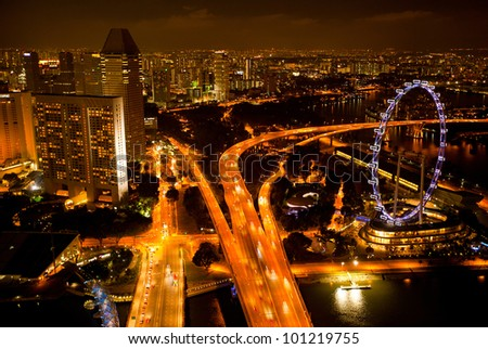 View of Singapore from roof Marina Bay hotel, in the night time. - stock photo