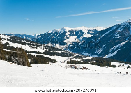 view of skiing area and downhill ski slopes in Saalbach Hinterglemm region, Austria - stock photo