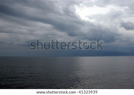 View of sky and sea few minutes before storm. - stock photo