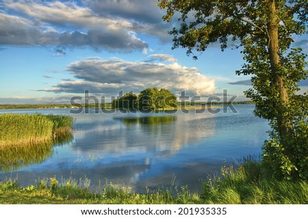 View of small island on the lake in Masuria district, Poland - stock photo