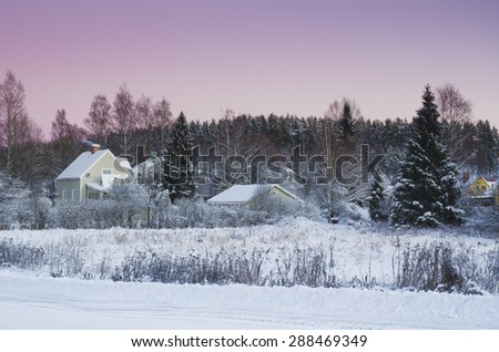 View of small swedish european  town Soderhamn at pink sunset - stock photo