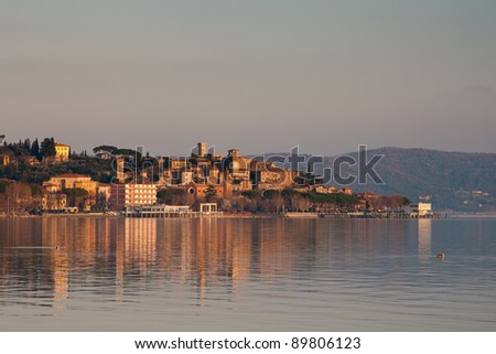 "View of small village of ""Passignano sul Trasimeno"" in Italy at sunset"