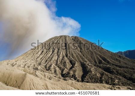 View of smoking active volcano Batok in Bromo Tengger Semeru National Park, East Java, Indonesia - stock photo
