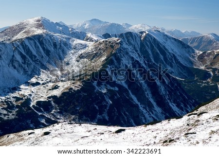 View of snowy ridges of Zapadne Tatry (Western Tatras) and Liptovske kopy mountains from Hladke sedlo (Smooth Pass), Cervene vrchy (Red Mountains), Western Carpathians, Slovakia.