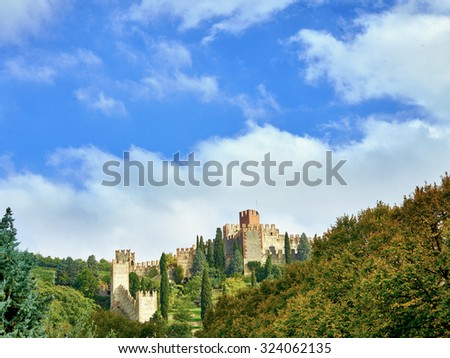 View of Soave (Italy) surrounded by vineyards that produce one of the most appreciated Italian white wines, and its famous medieval castle. - stock photo