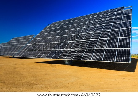 View of solar panels against a blue sky - stock photo