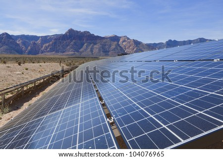 View of solar panels in the Mojave Desert. - stock photo